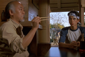Mr. Myagi tries to catch a fly with chopsticks