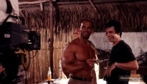 Schwarzenegger having a cigar with McTiernan behind the scenes