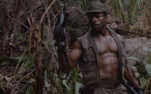 Carl Weathers as the muscular Dillon
