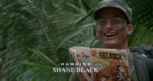 Writer Shane Black portrays the nerdy soldier Hawkins