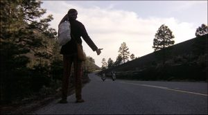 The bikers pick up a hitchhiker on their trip