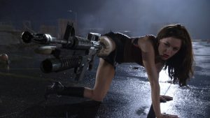 Just a girl shooting zombies with her leg in Planet Terror